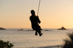 Woman On Rope Swing Royalty Free Stock Photos