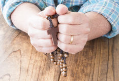 Woman with Rosary Beads Stock Image