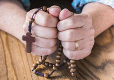 Woman with Rosary Beads Stock Images