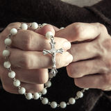 Woman  with rosary Stock Photo