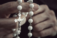 Woman  with rosary Stock Photography