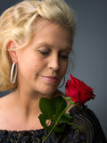 Woman and rose Stock Image