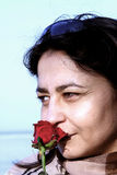 Woman with a rose stock image