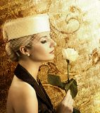 Woman with rose. Beautiful woman with rose over abstract vintage background Royalty Free Stock Photo
