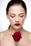 Woman with rose and closed eyes Royalty Free Stock Photo