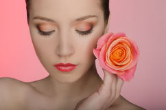 Woman with a rose closed her eyes Royalty Free Stock Images