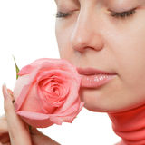 The woman with a rose closeup Stock Photography