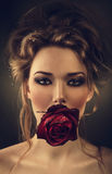 Woman with rose and drops in hair Stock Photo