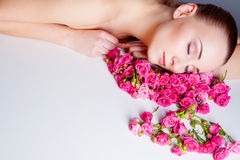 Woman with rose flowers Stock Photo