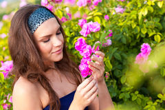 Woman in rose garden Stock Images
