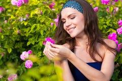 Woman in rose garden Stock Photos