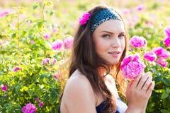 Woman in rose garden Stock Image