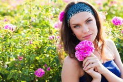 Woman in rose garden Royalty Free Stock Image