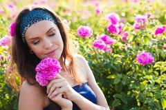 Woman in rose garden Stock Photo