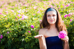Woman in rose garden Royalty Free Stock Images