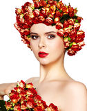 Woman with rose in hair Stock Photo