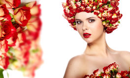 Woman with rose in hair Stock Image