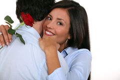 Woman with rose in hand Royalty Free Stock Images