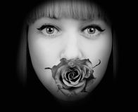 Woman with rose in her mouth Royalty Free Stock Photos