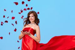 Woman with rose petals Royalty Free Stock Images