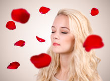 Woman with rose petals Stock Images