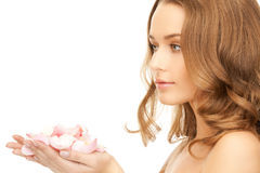 Woman with rose petals Stock Photo