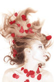 Woman with rose petals in her hair Royalty Free Stock Photo