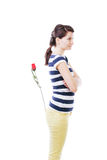 Woman with rose in pocket Stock Images