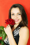 Woman with rose on a red Royalty Free Stock Images