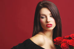 Woman with rose on red background Stock Photo