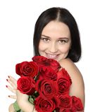 WOMAN WITH ROSES. Beautiful smiling woman with red roses Stock Images