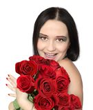 WOMAN WITH ROSES. Beautiful smiling woman with red roses Royalty Free Stock Photo