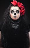 Woman with roses dressed up for All Souls Day Stock Photo