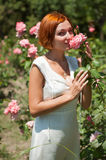 Woman in roses garden. Royalty Free Stock Photography