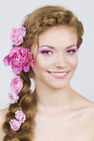 Woman with roses in hair Royalty Free Stock Photography