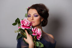 Woman with roses Stock Photos