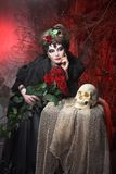 Woman with roses and skull Stock Photography