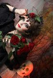 Woman with roses and skull Royalty Free Stock Image