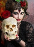 Woman with roses and skull Royalty Free Stock Images