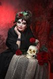 Woman with roses and skull Royalty Free Stock Photos