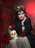 Woman with roses and skull Stock Photo
