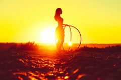 Girl with hoops in nature stock image