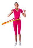Woman rotates hula hoop on white background Royalty Free Stock Photography