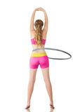 Woman rotates hula hoop Stock Photography