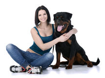 Woman with a Rottweiler dog Royalty Free Stock Photos