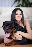 Woman with a Rottweiler dog Stock Photography