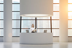 Woman at round reception desk Royalty Free Stock Image