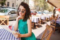 Woman in round sunglasses with cocktail making order at cafe stock photos