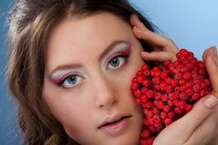 Woman with rowan berry Stock Photography