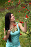 Woman with rowan Royalty Free Stock Image